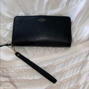 A black Kate Spade wristlet purse